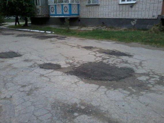 Письмо в редакцию - про ямы на дороге возле олимпийских домов (фото)